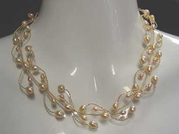 5200 Series Peach pearl necklace