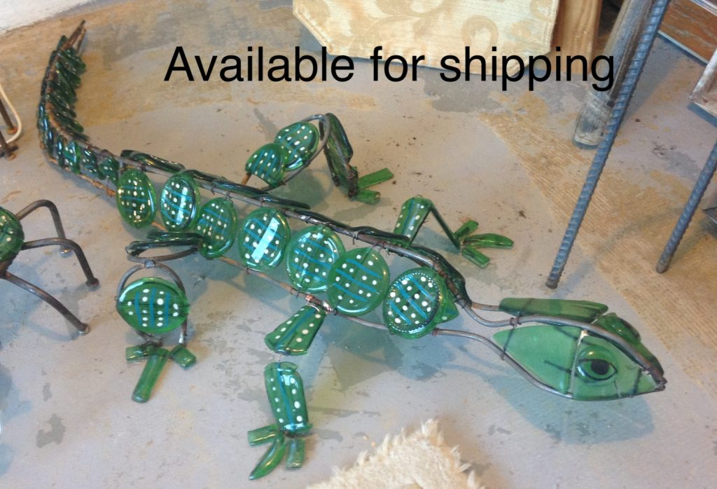 Green lizard sculpture in glass